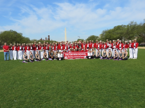 The Dalton High School Catamount Marching Band poses on the National Mall with the Washington Monument in the background before participating in the National Cherry Blossom Festival Parade.